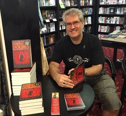 Paul Kane signing copies of Sherlock Holmes and the Servants of Hell
