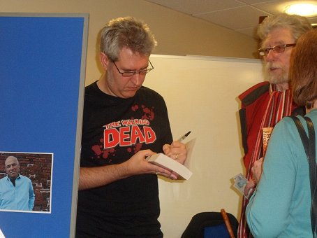 Paul Kane signing copies of Mammoth Bookd of Body Horror