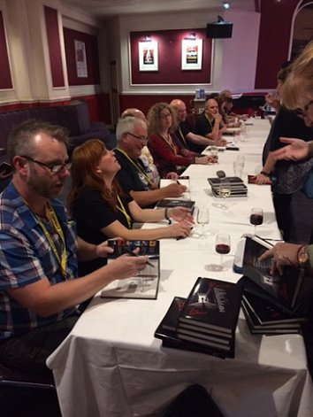 Author signing for Ten Tall Tales
