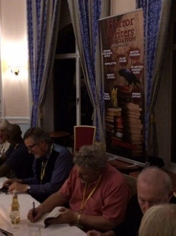 Signing at the party. L to R: Jan Edwards, C.C. Adams, Reggie Oliver, Robert Shearman, Stephen Jones